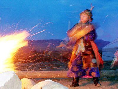 siberian shaman woman dancing & drumming